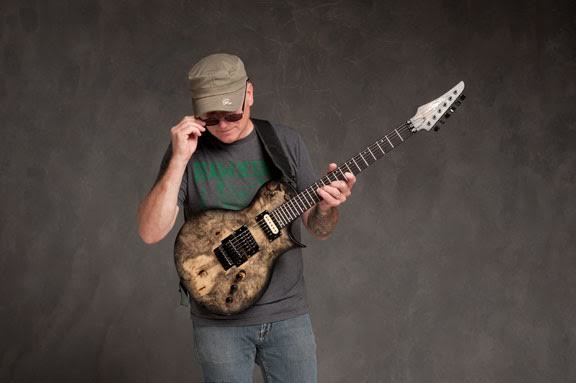 Chris Poland with his signature Legator CP6 guitar