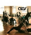 Image Description: Dancers with and without wheelchairs improvising in pairs. The room is filled with warm yellow light