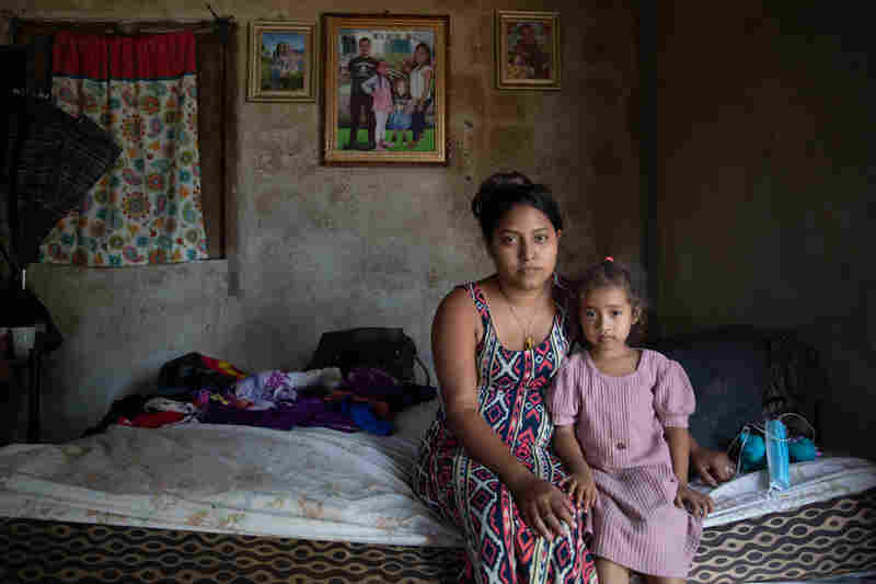 Karen Ramos and her daughter Allison at their home in La Independencia, La Lima. The family home had been completely submerged after Hurricanes Eta and Iota tore through Northern Honduras in early November 2020.